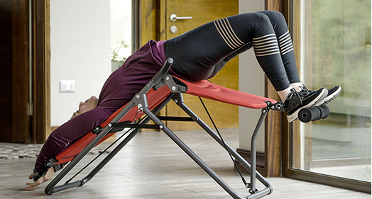 Woman using Backlounge in a upside down position